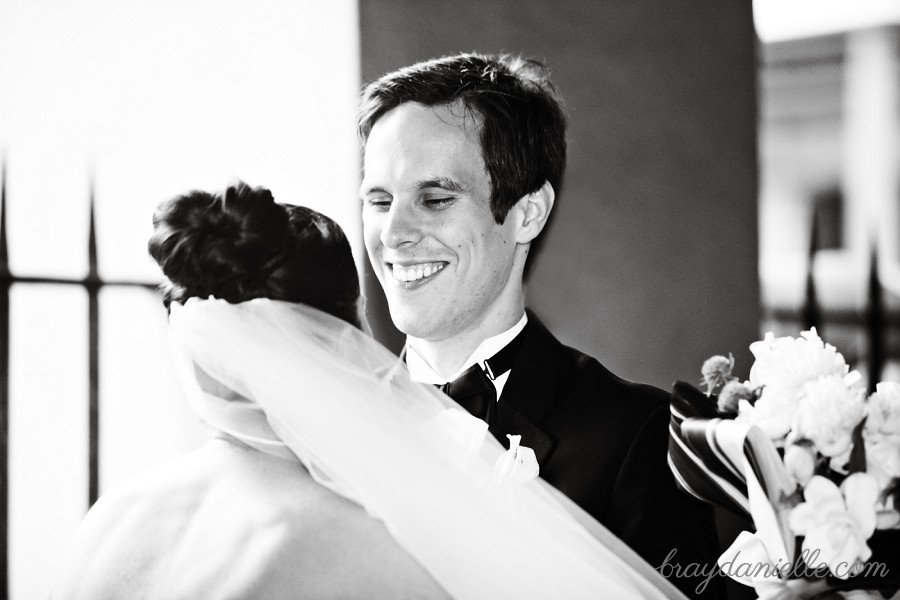 groom smiling at bride first look