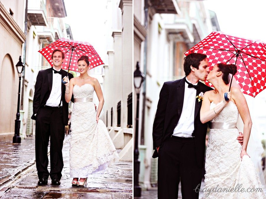 bride and groom with red umbrella