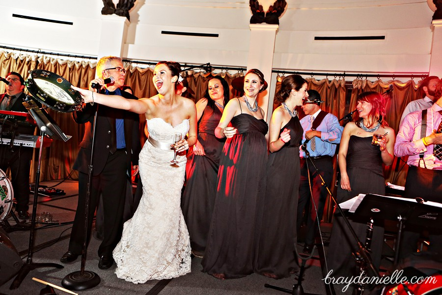 bride singing on stage, wedding by Bray Danielle Photography