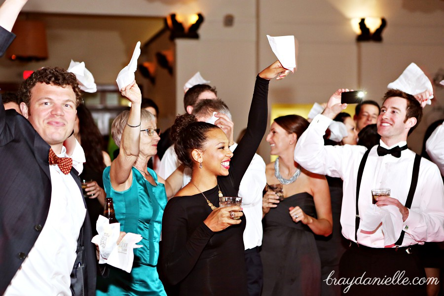 Wedding guest waving the white napkin, wedding by Bray Danielle Photography