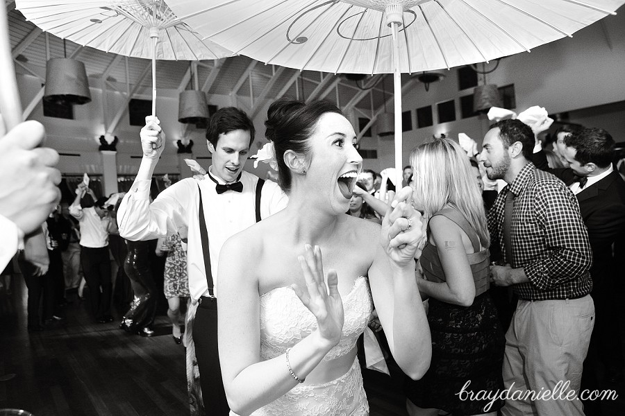 Bride and groom dancing with parasols second line, wedding by Bray Danielle Photography