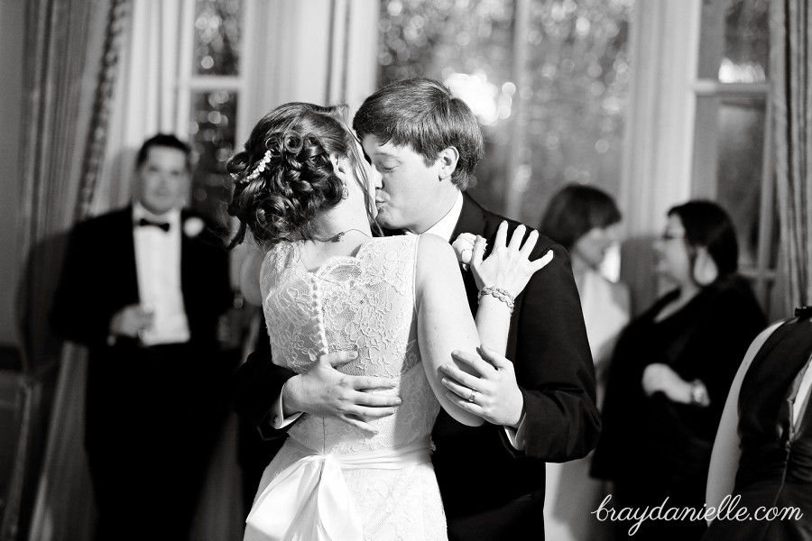 bride and groom kissing while dancing