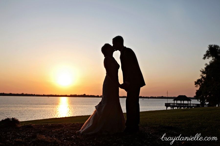Romantic silhouette of bride and groom at sunset