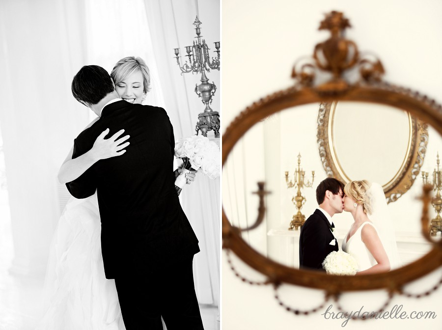 bride and groom kiss in mirror