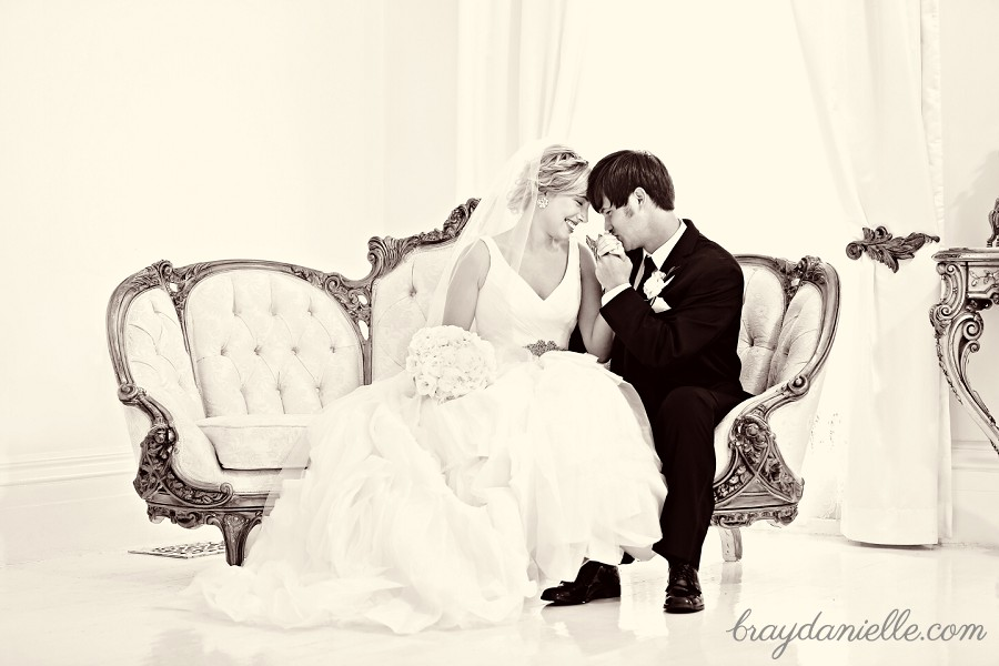 beautiful bride and groom sitting on couch