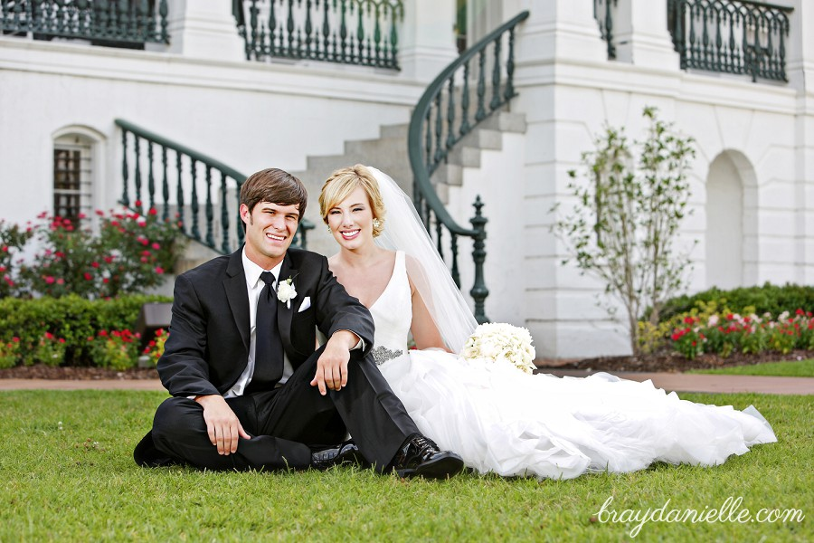 portrait of bride and groom sitting outside