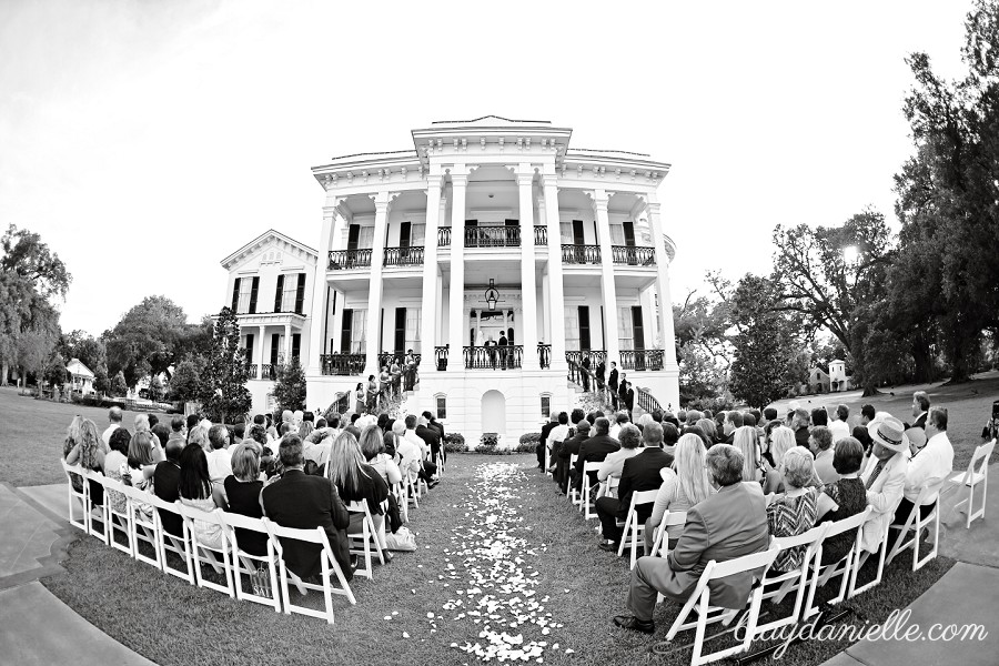 beautiful outdoor wedding ceremony in front of mansion