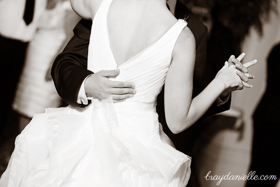 close up details of bride and groom dancing