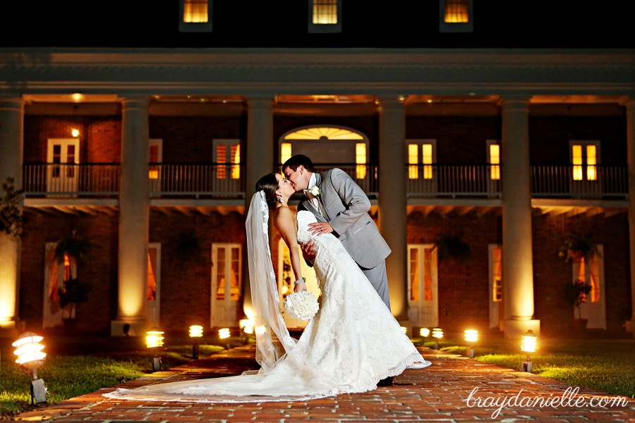 Romantic Photo Of Bride And Groom Kissing In Front White Oak Plantation