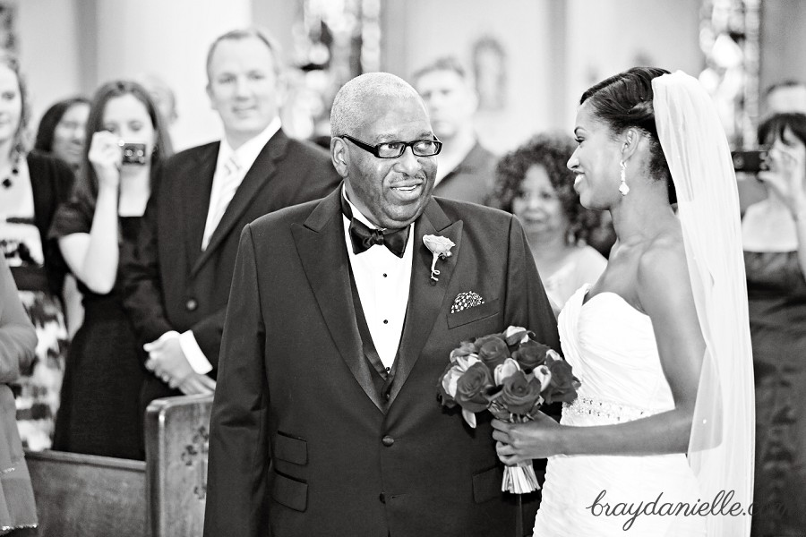 Father of the bride smiling at bride, wedding at St Louis Cathedral in New Orleans