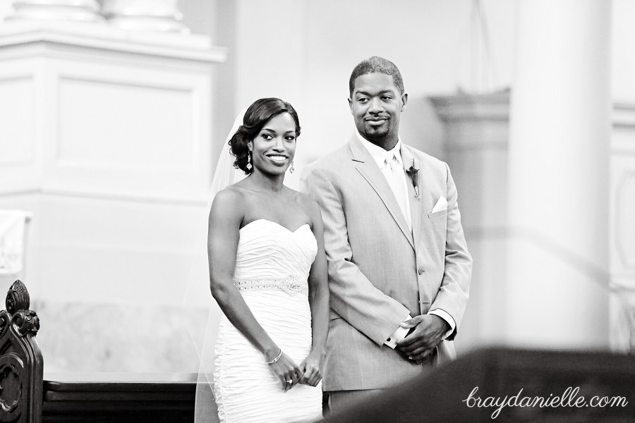 Bride and groom during ceremony, wedding at St Louis Cathedral in New Orleans