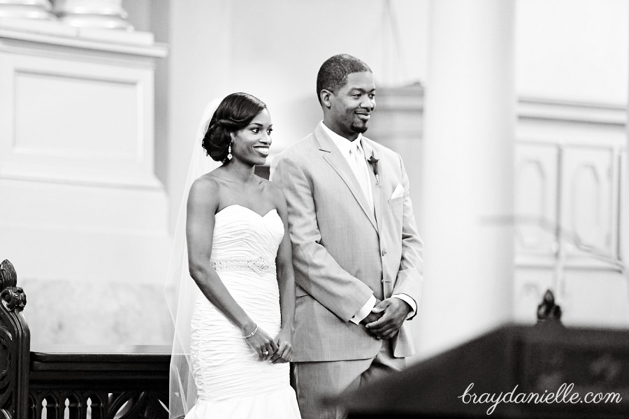 bride and groom during Catholic ceremony, wedding at St Louis Cathedral in New Orleans