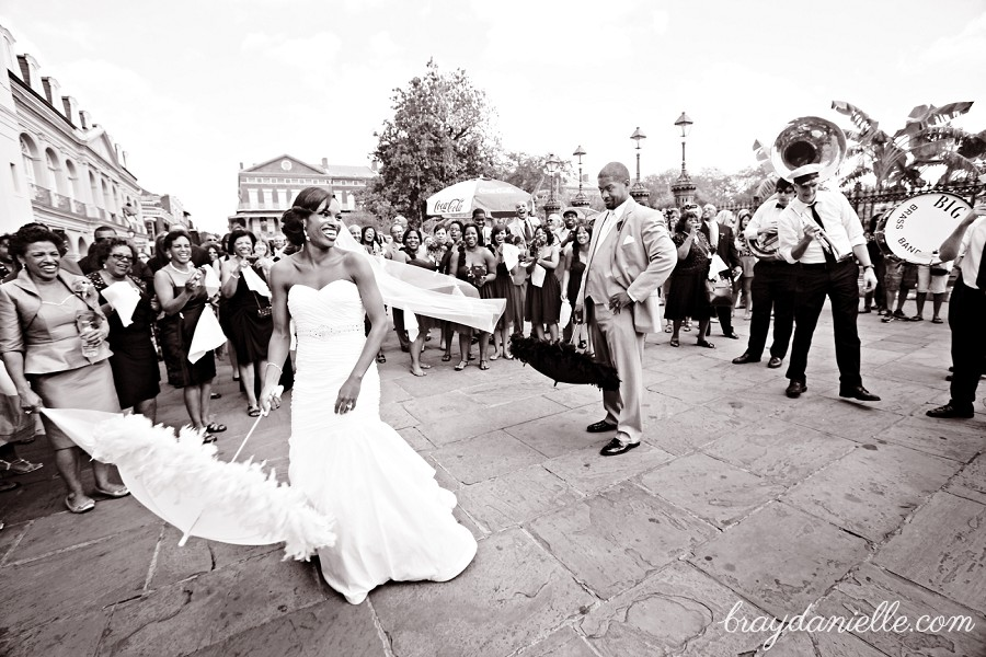bride and groom dancing outide in new orleans