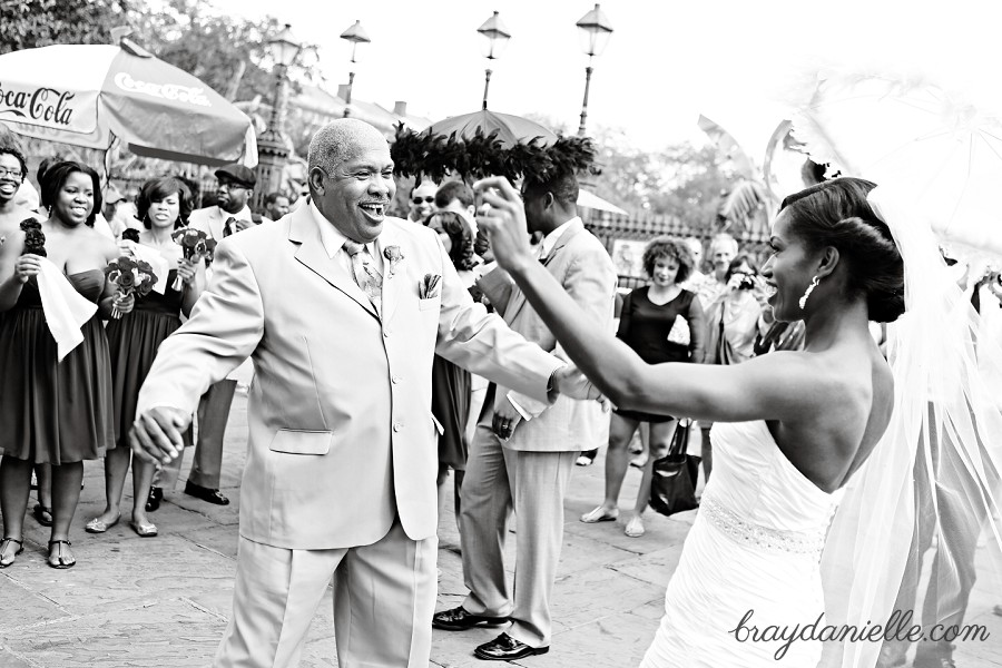 father of the bride and bride dancing outside