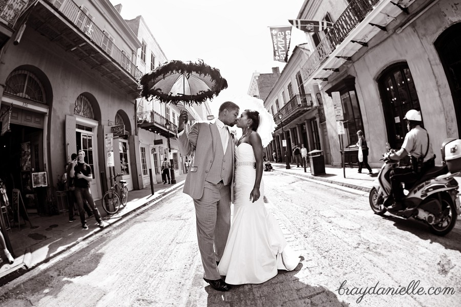 bride and groom kissing on new orleans street