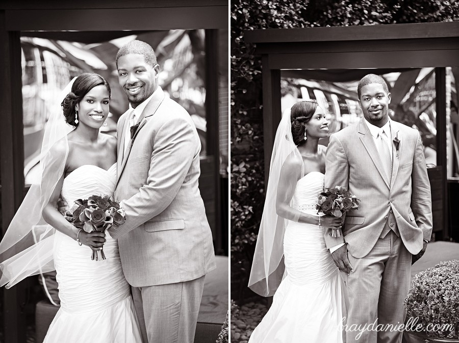 black and white posed photo of bride and groom