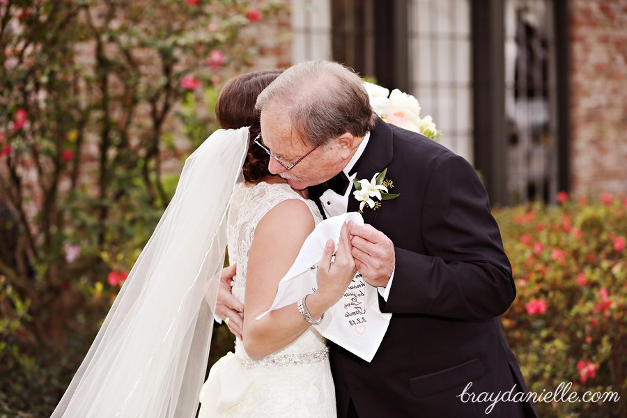 father of the bride hugging