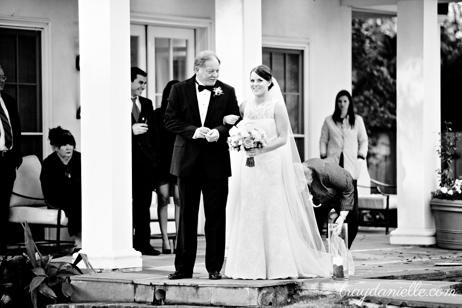 Bride standing with father