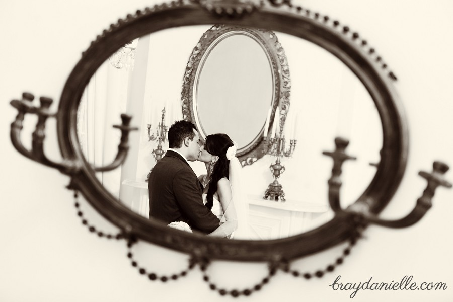bride and groom in mirror