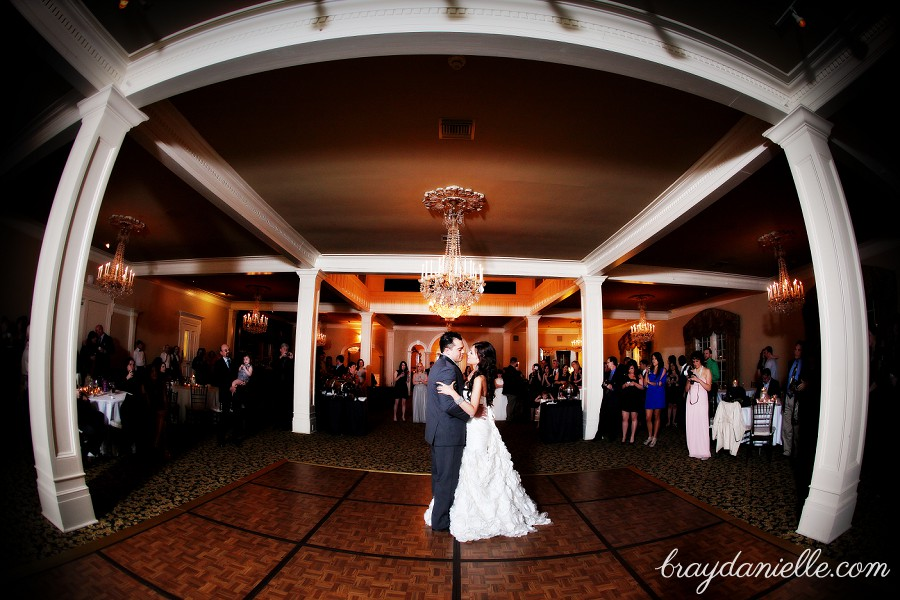 wide angle bride and groom dancing